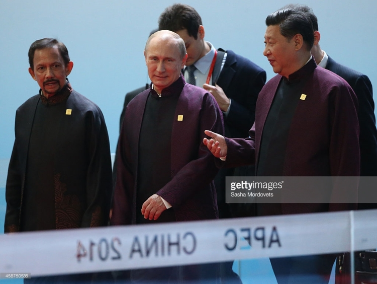 BEIJING, CHINA - NOVEMBER,10: Chinese President Xi Jinping (R), Brunei Sultain Hassanal Bolkiah (L)  and Russian President Vladimir Putin (C) attend a family photo ceremony during the APEC Leaders meeting in Beijing, China. (Photo by Sasha Mordovets/Getty Images)